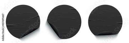 Obraz na plátne Glued round black stickers with curled edges set isolated on white background