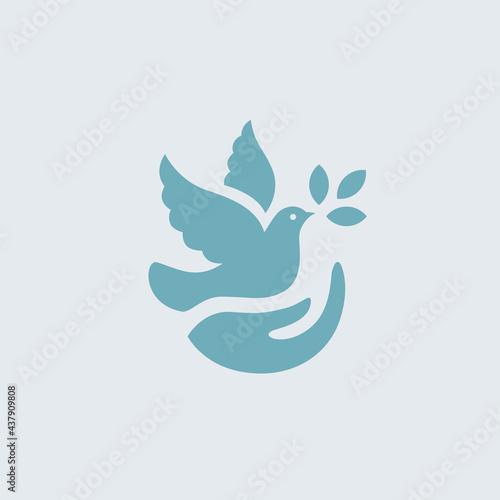 Fotografia Dove icon with hand and olive leaf symbol