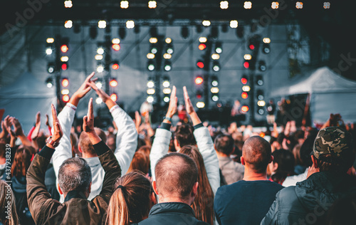 many different people at a concert listening to rock band music open air Poster Mural XXL