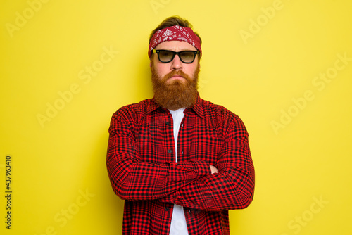 Tableau sur Toile Serious man with beard and bandana in head