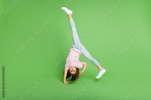Fotografie, Tablou Full size photo of young girl handstand balance show peace cool v-sign isolated