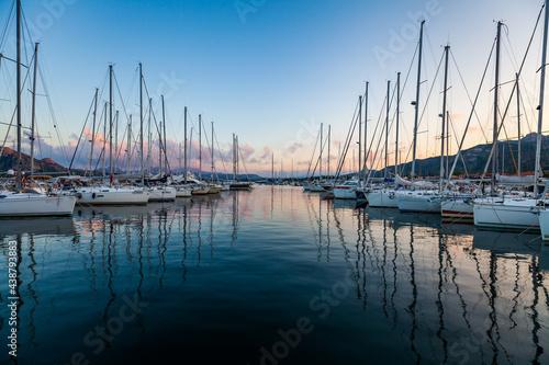 Canvastavla Marina yacht club on the European island of Sardinia at sunset