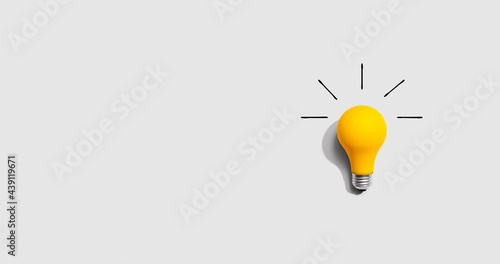 Yellow light bulb Fototapeta