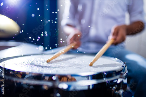 Fotografering indian man playing the drums sticks close-up in recording studio