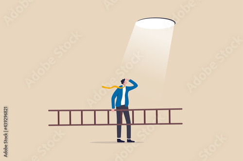 Tela Business hope to solve crisis problem, plan and strategy to reach achievement, ladder of success concept, businessman holding ladder looking at hope light planning to climb and escape through hole