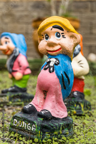 Fototapeta Garden with sculpture of Snow White and the seven dwarfs
