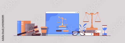 Fotografia law and justice concept gavel judge books and scales on laptop screen online law