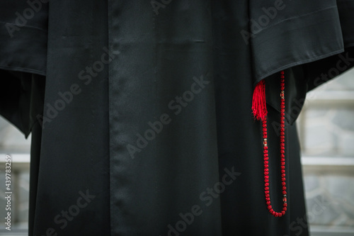 Details with the prayer rope and robe of a high ranking Romanian priest (archimandrite) Fototapet