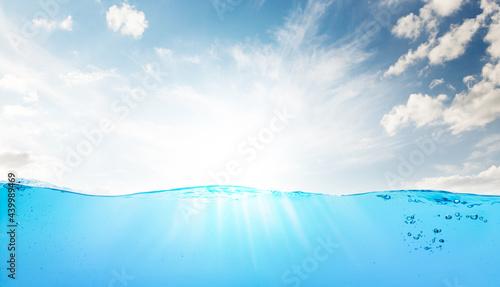 Fotografie, Obraz Waterline with sea underwater and blue sunny sky