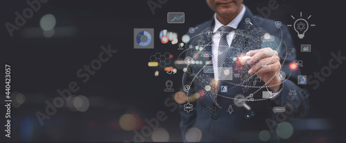Digital marketing, Global business, IoT Internet of Things, business strategy concept. Businessman touching on global network with technology icons