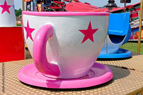 Fotografie, Tablou Teacup ride at fair. Close up of Large pink and white teacup.