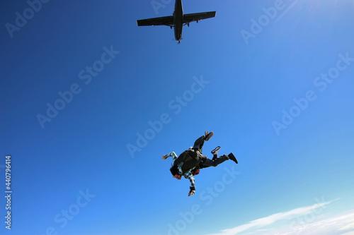 Tandem parachute jump. Beautiful Brazilian woman.