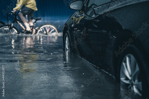 car in a deep puddle Fototapet
