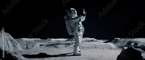 Fotografering WIDE Male actor in astronaut suit making selfie on a Moon Lunar movie shooting set