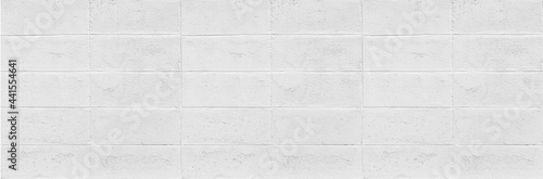 Carta da parati Panorama of White cement block fence texture and seamless background