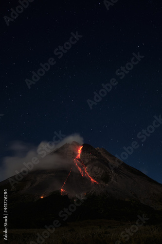 Mount Merapi erupts with high intensity at night during a full moon, the slide o Fototapet