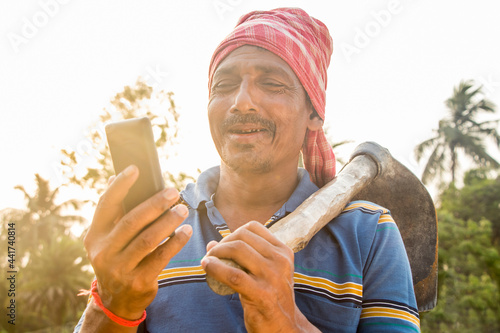 Fotografija Rural Indian Man Holding mobile phone