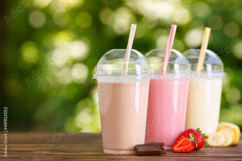 Canvas Print set of different milkshakes in disposable plastic glasses
