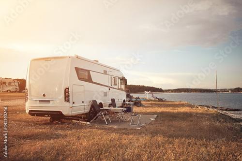 Camper van house camp near the ocean sea shore. Poster Mural XXL
