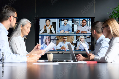 Cuadros en Lienzo Global corporation online videoconference in meeting room with diverse people sitting in modern office and multicultural multiethnic colleagues on big screen monitor