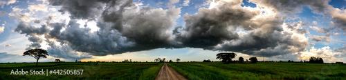 Fotografie, Obraz Panorama road to Dark sky and dramatic black cloud before rain
