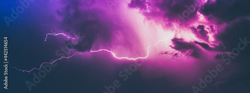 Fotografie, Tablou Thunderstorm lightning in dramatic sky in purple and blue