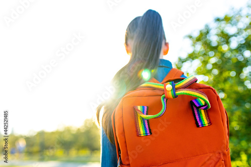girl student wears backpack outdoors in summer park Fototapete