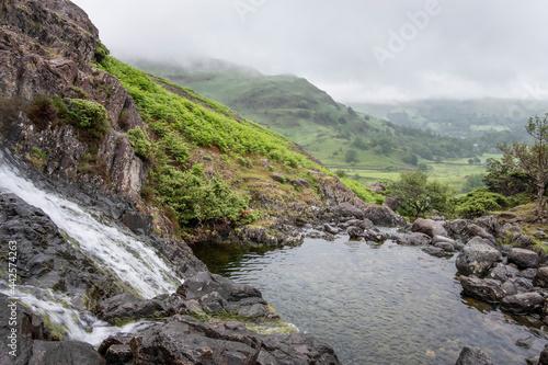 Fototapeta Waterfalls on Sourmilk Gill near Easedale Tarn, near Grasmere in the Lake District, UK