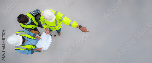 Banner : Civil engineer inspect structure at construction site against blueprint, Building inspector join inspect building structure with civil engineer. Civil engineer hold blueprint inspect building