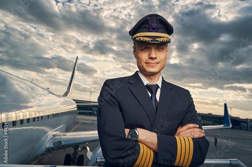 Fotografija Serious aviator posing for the camera before the flight