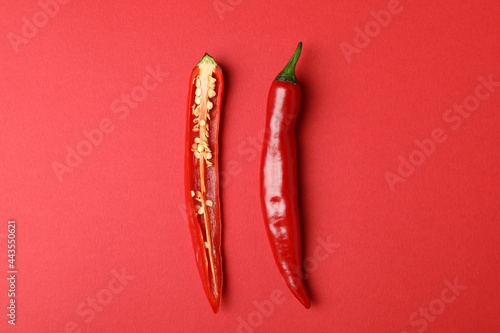 Fotomural Red hot chili pepper on red background