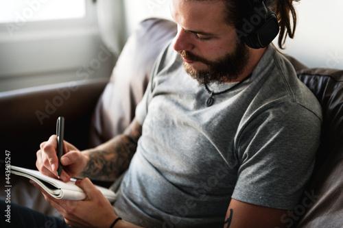 Fotografie, Obraz Caucasian man in a songwriting process