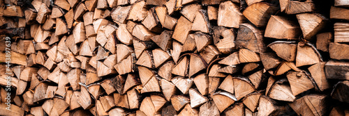 Fototapeta textured firewood background of chopped wood for kindling and heating the house