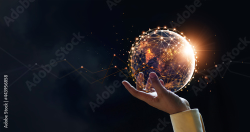 .Businessman holding night earth and global networking connection and data exchanges, global communication network concept, Elements of this image furnished by NASA. #443956858