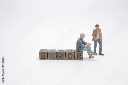 Wallpaper Mural Error - cube with letters, sign with metal cubes with figure