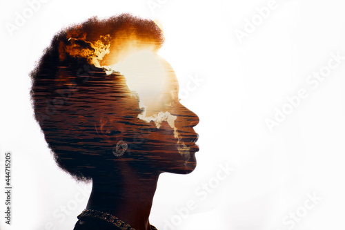 Canvas-taulu Multiple exposure image with sunrise and sea inside african american woman silhouette