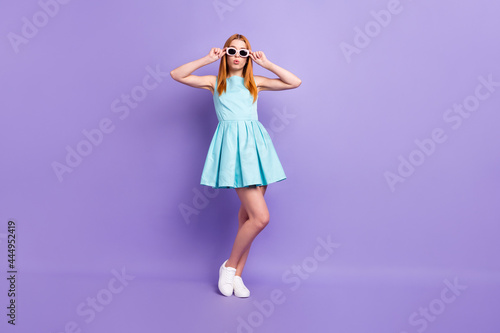 Full size photo of young attractive girl hands touch sunglass wear glamour dress isolated over purple color background