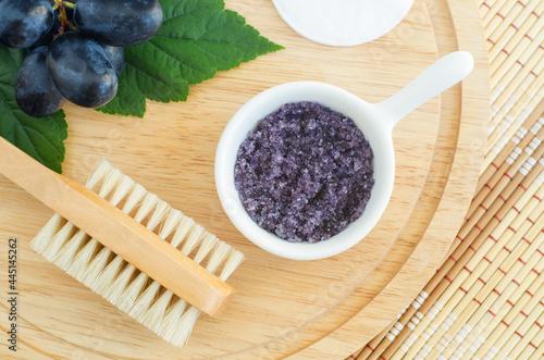 Obraz na plátně Small white bowl with homemade grape and sugar body scrub (bath salt, foot soak) Natural beauty treatment and spa recipe
