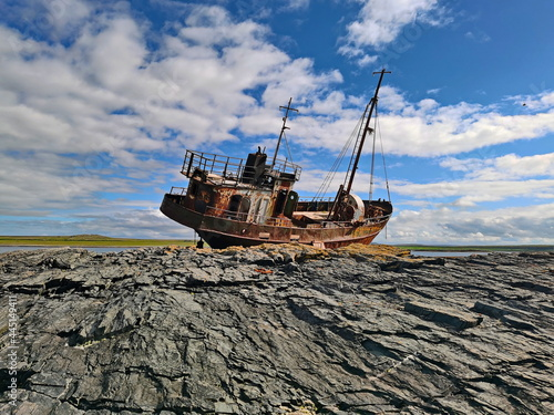Fototapeta A fishing vessel thrown by a storm on the shores of the Barents Sea