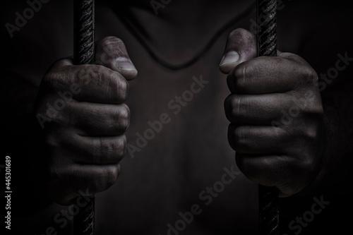 Obraz na plátně closeup on hands of man sitting in jail