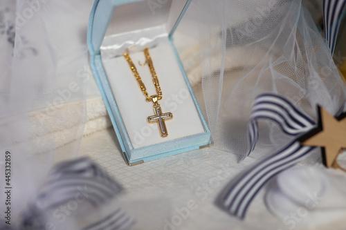 Fotografering gold baptismal cross
