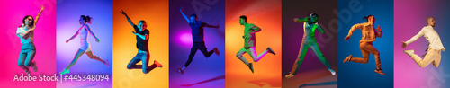 Photo Portrait of group of people jumping isolated on multicolored background in neon light, collage