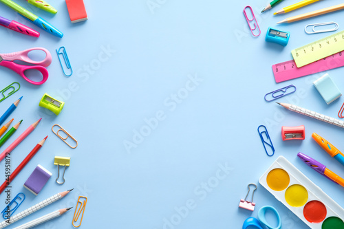 Flat lay colorful school supplies on blue background Poster Mural XXL