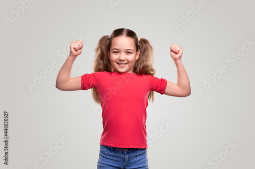Fototapeta Strong child smiling and showing biceps