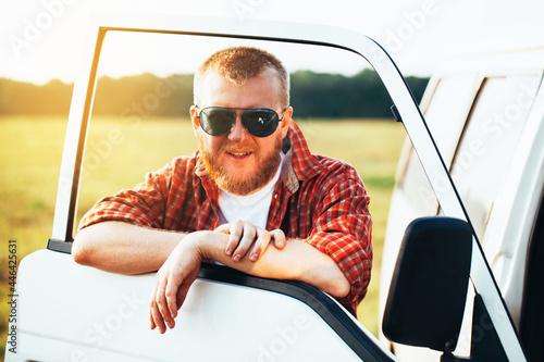 Driver in sunglasses stands near his car Tapéta, Fotótapéta