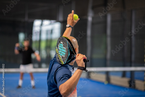 Stampa su Tela Monitor teaching padel class to man, his student - Trainer teaches boy how to pl