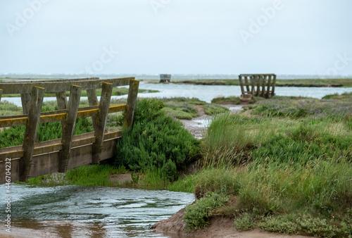 Canvas Print Wooden pedestrian bridges in the salt marshes at Stiffkey near Holt in North Norfolk, East Anglia UK
