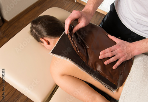 Photo Fango massage is used for fango paraffin compresses