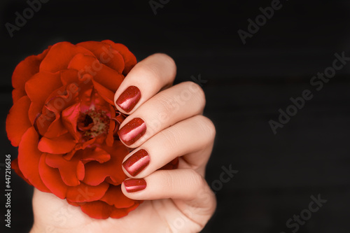 Canvas Print Female hand with red nail design