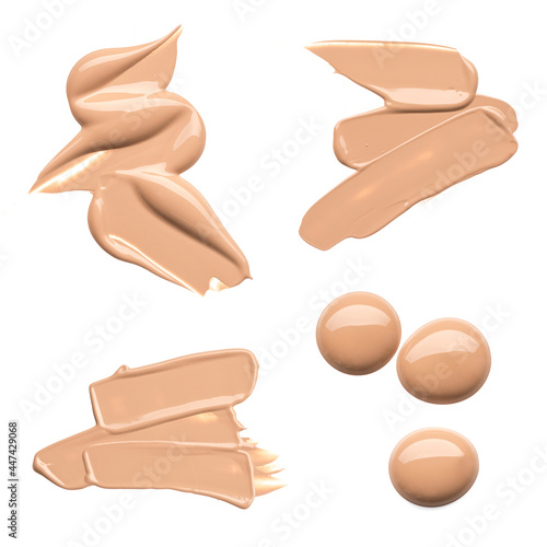 Fotografiet Set of smears of light beige foundation or acrylic paint, isolated on white background